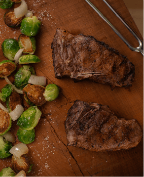 Iberico Chops, served with brussels sprouts cooked in bacon